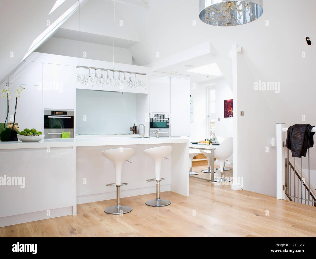 """White Breakfast Bar white """"bombo"""" stools at breakfast bar in modern white loft"""