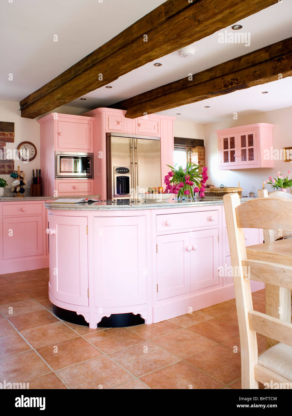 Kitchens With Terracotta Floors Pastel Pink Fitted Units And Beamed Ceiling In Country Kitchen