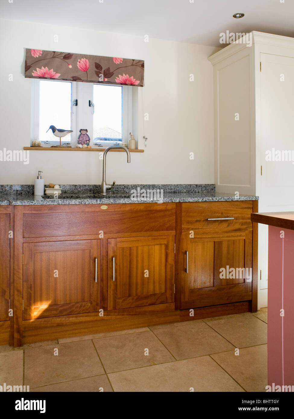 Dark Wood Country Kitchen floral blind on small window above sink in modern country kitchen