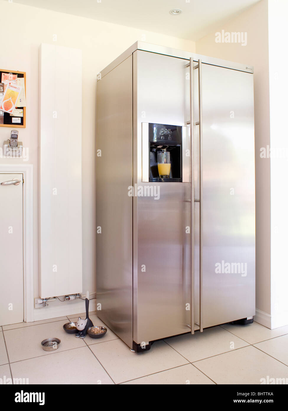 Charming Large American Fridge Freezer Part - 14: Large American-style Stainless-steel Fridge-freezer Beside Vertical White  Radiator In Modern Kitchen