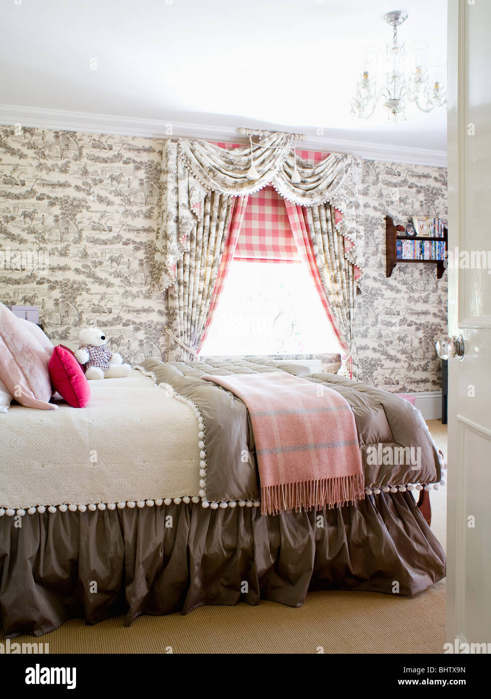 grey toile de jouy wallpaper and curtains in country bedroom with red