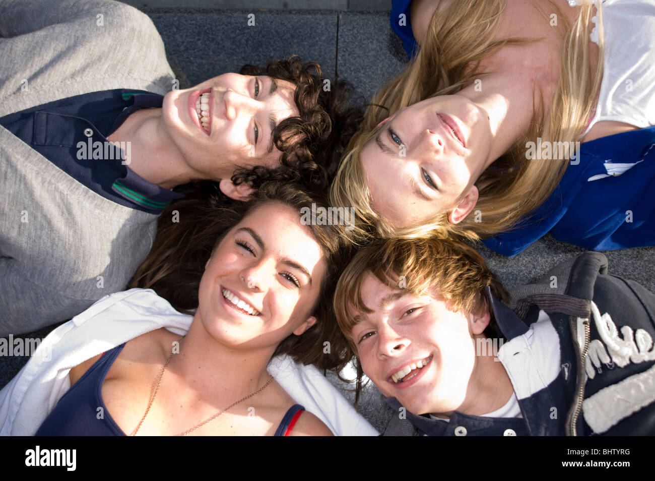 Teenagers. 2 Boys 2 Girls All Lay Down Looking Up Laughing