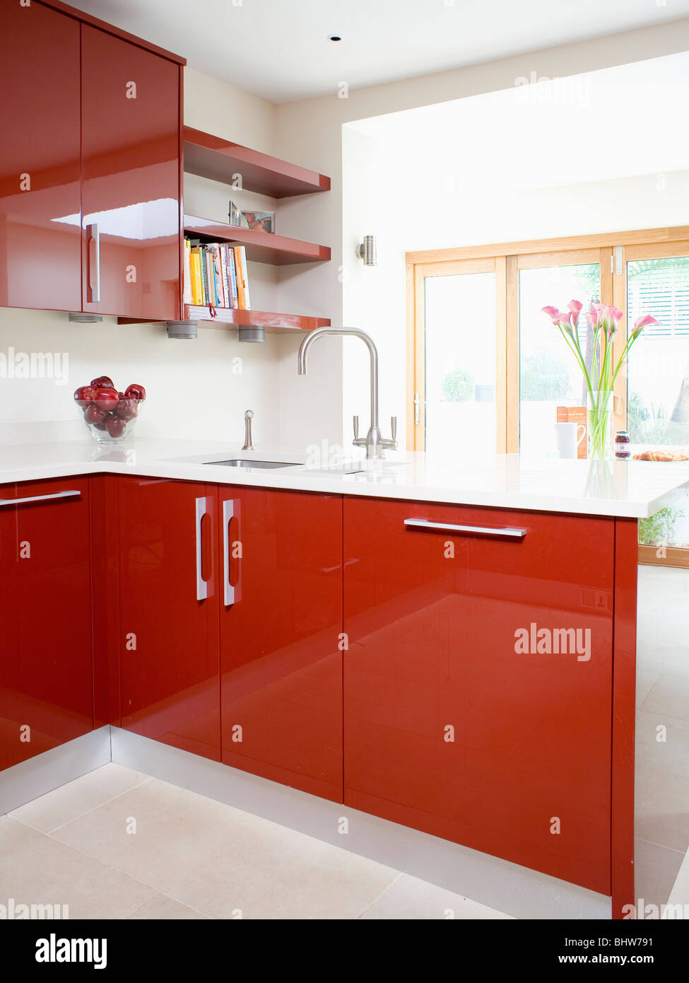 Shiny red lacquered doors on fitted units with white for Red fitted kitchen