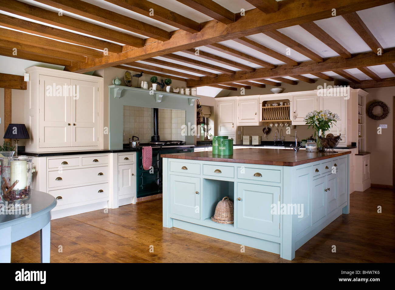 Pastel Blue Island Unit In Large Cream Country Kitchen With Beamed Ceiling