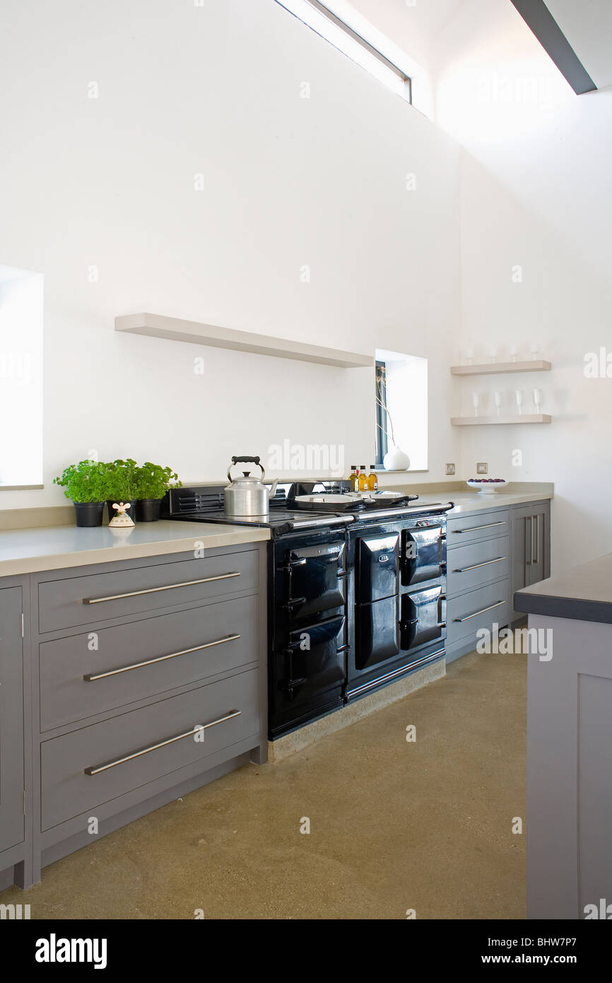 Black Aga Oven In Large Modern White Kitchen With Fitted Gray Units Stock Photo Royalty Free
