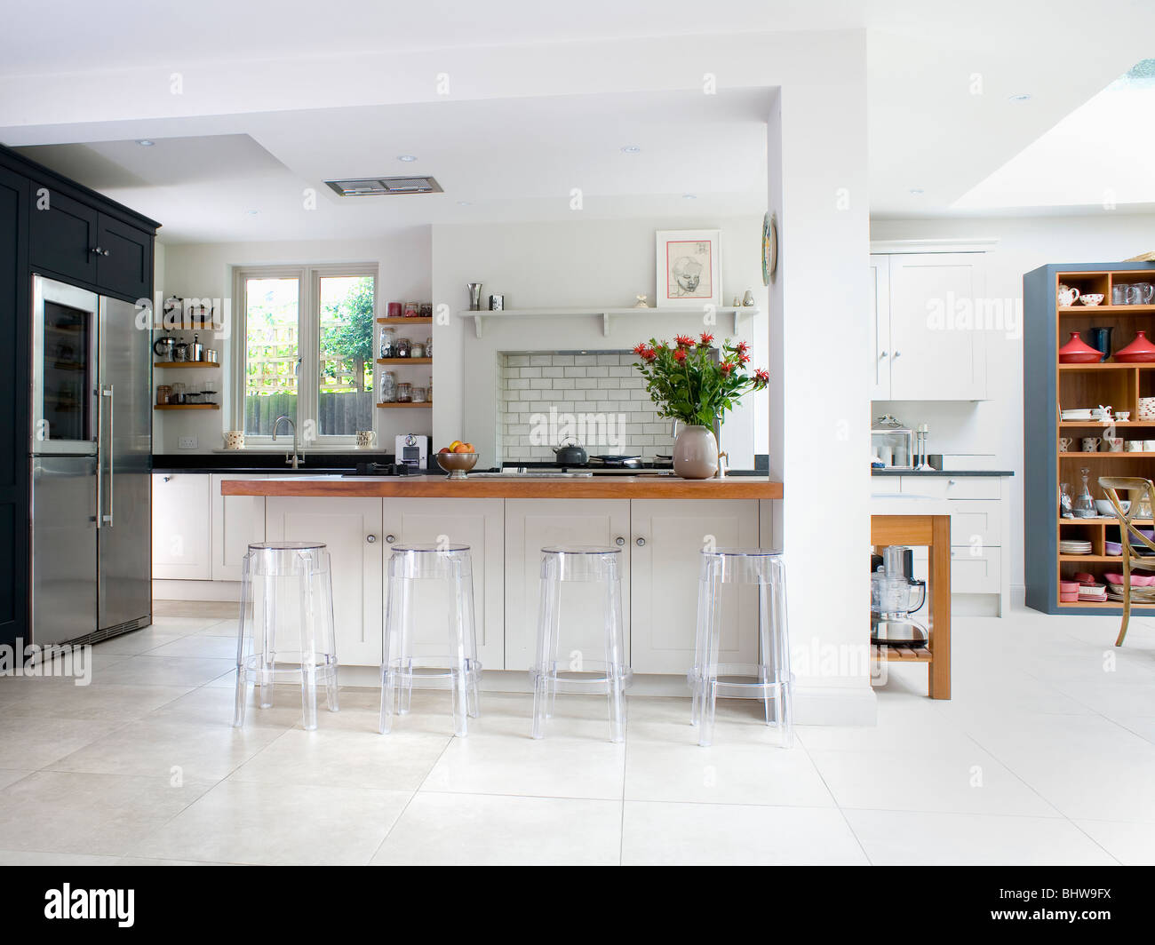 White Kitchen Extensions perspex stools at breakfast bar in large modern white kitchen
