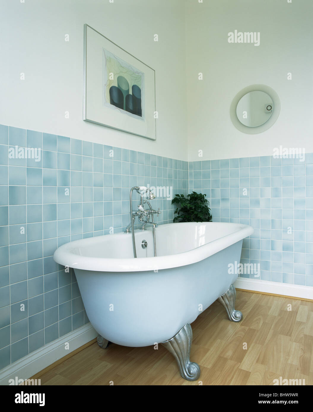 pale blue roll top bath in modern bathroom with pastel