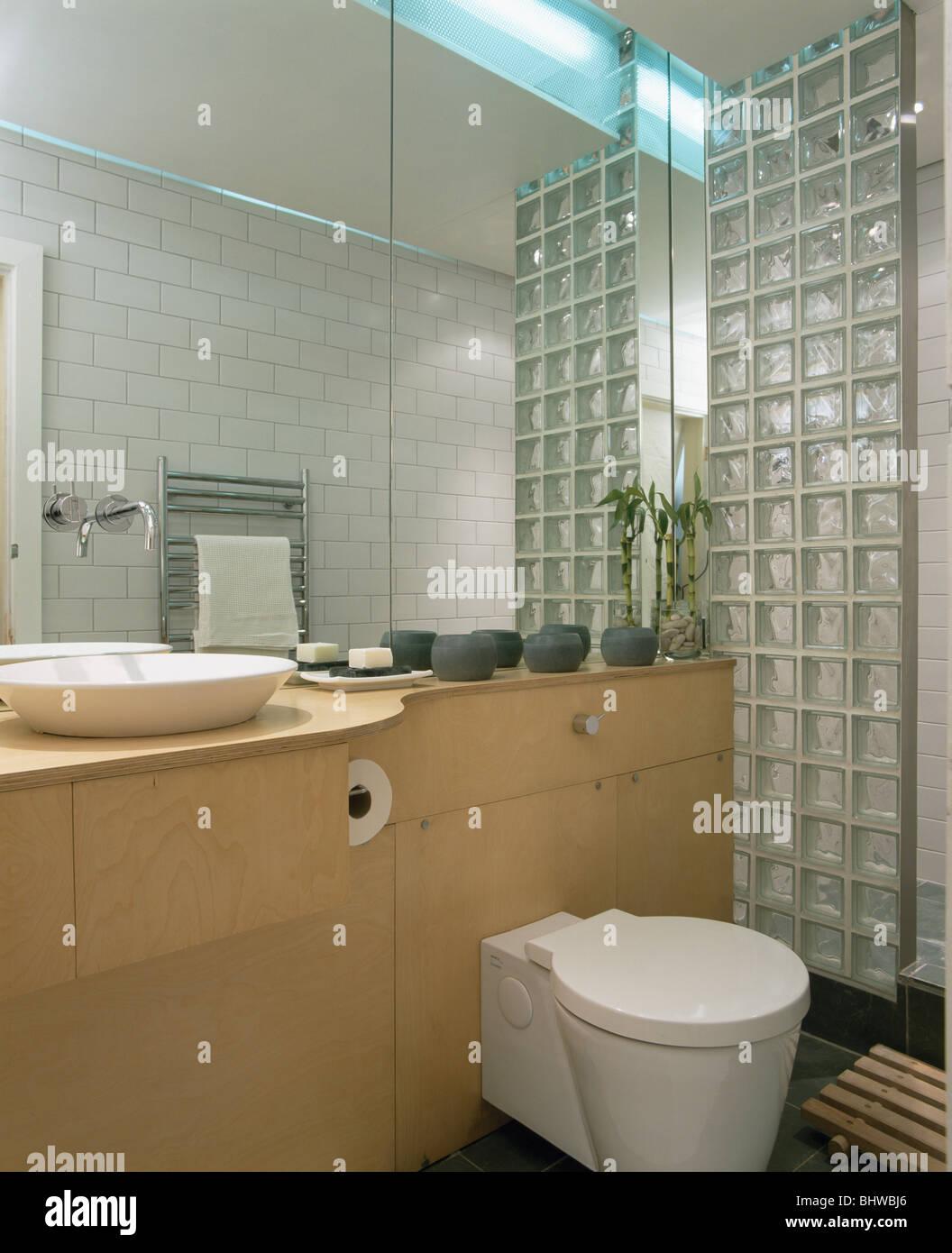 Glass bricks in bathroom - Glass Brick Wall In Modern Bathroom With Mirrored Wall Above Vanity Unit