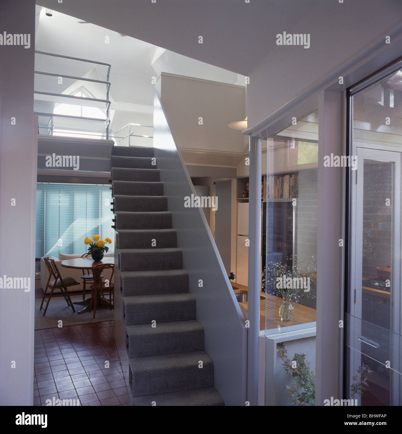 Grey Carpet On Open Staircase In Modern Plan Hall Dining Room