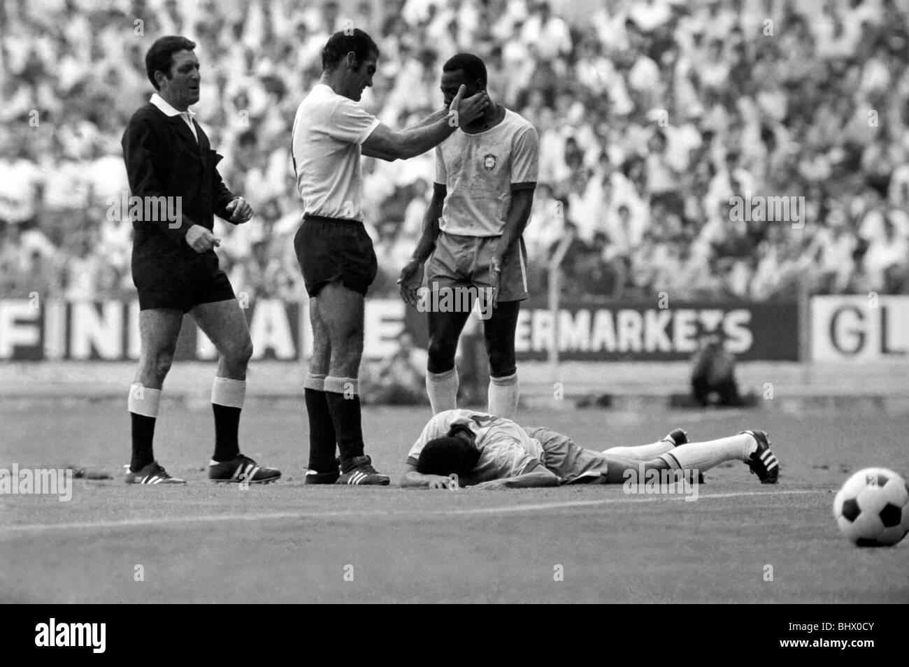 Pele calmed down by Uruguain player whilst felled Jairzinho lies