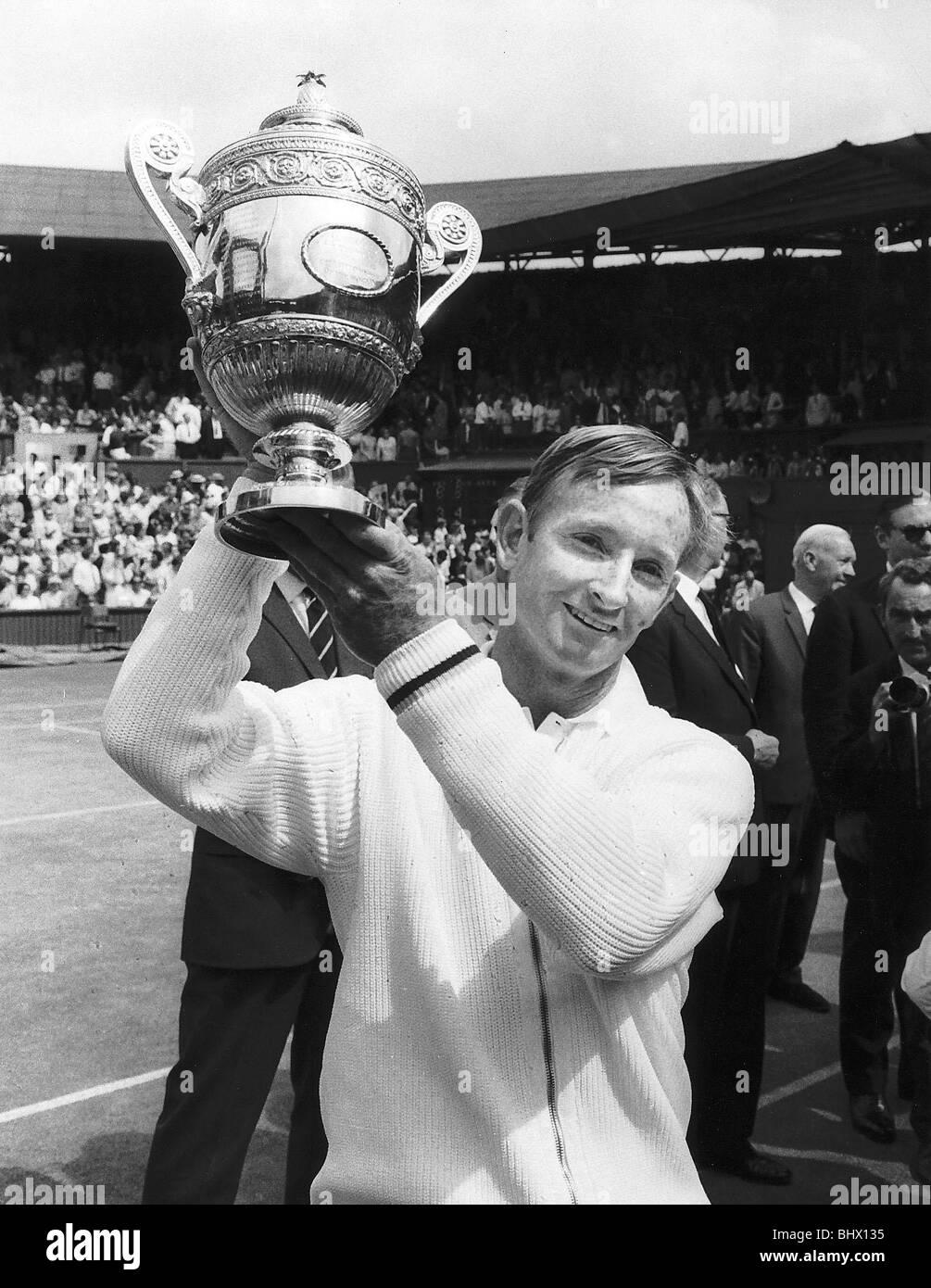 Rod Laver tennis player hold mens singles Wimbledon trophy aloft