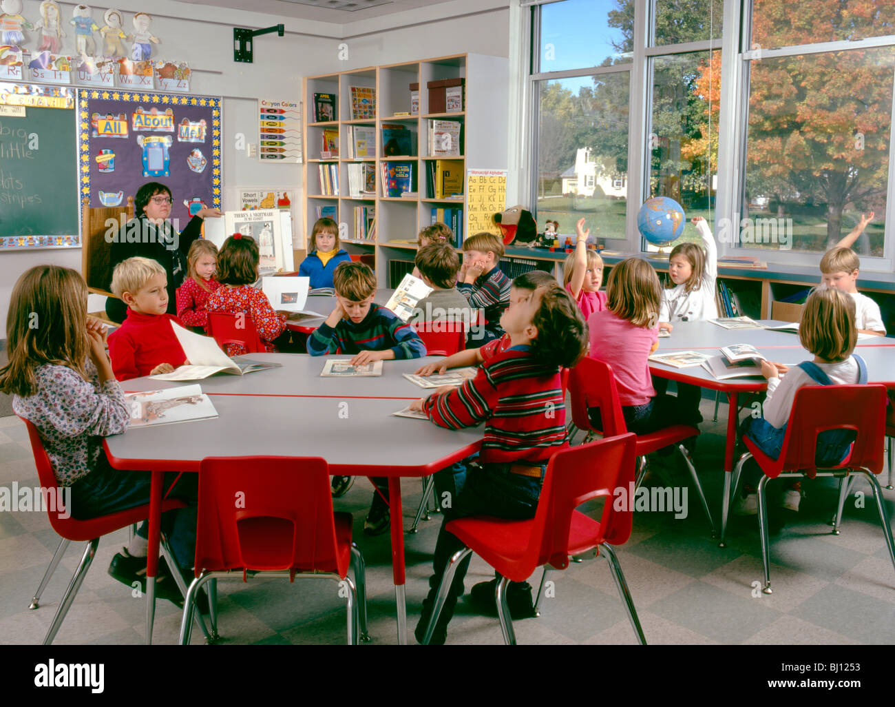 Elementary Classroom Students : Teacher and students in an elementary school classroom