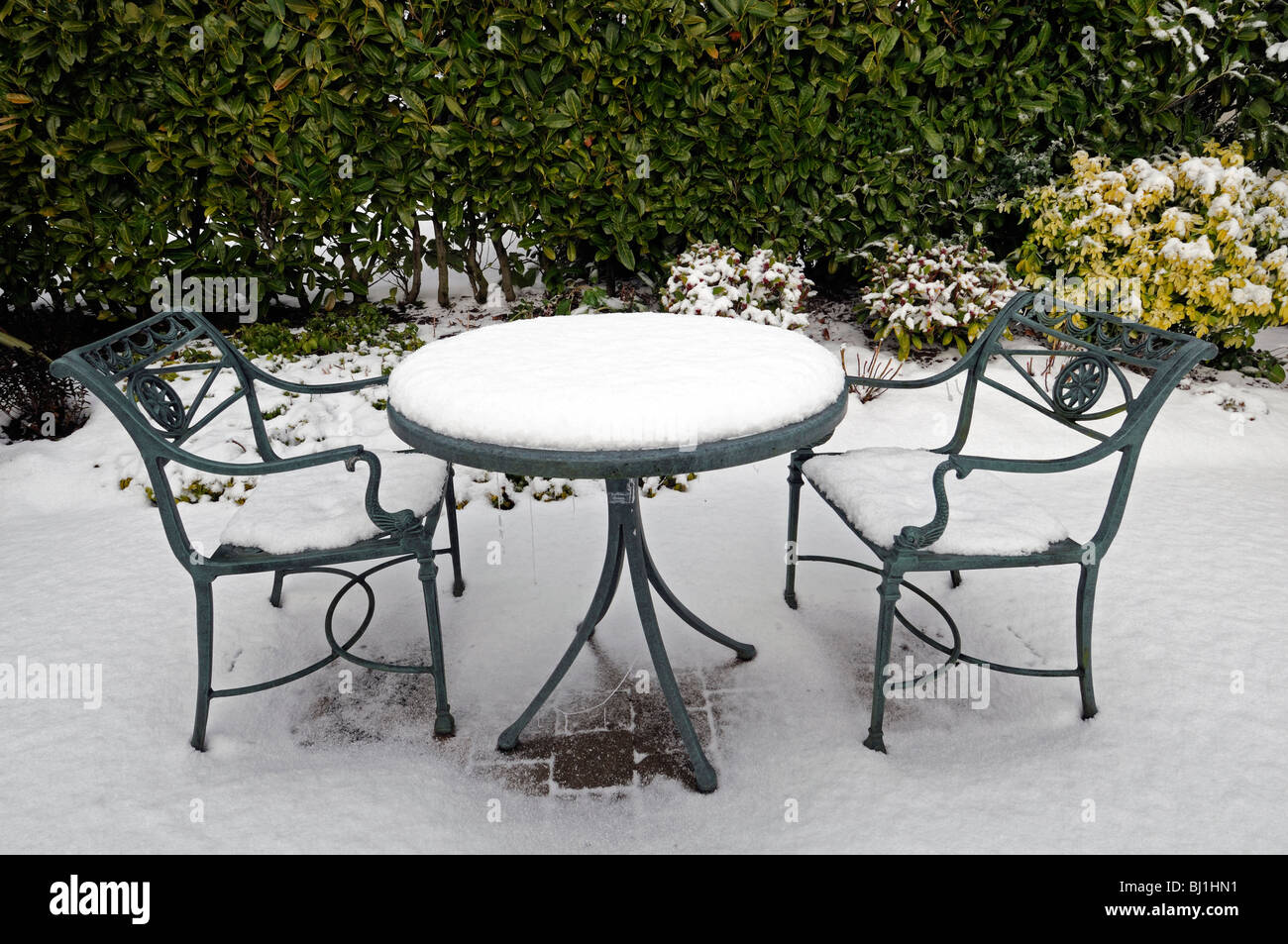 Stock Photo Rustic Wrought Iron Garden Seat Table Cover Covered With Snow Winter Wonderland Gardening Scene Scenic