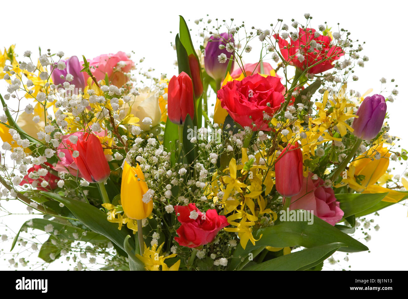 bouquet of spring flowers in clear glass vase isolated as a cutout