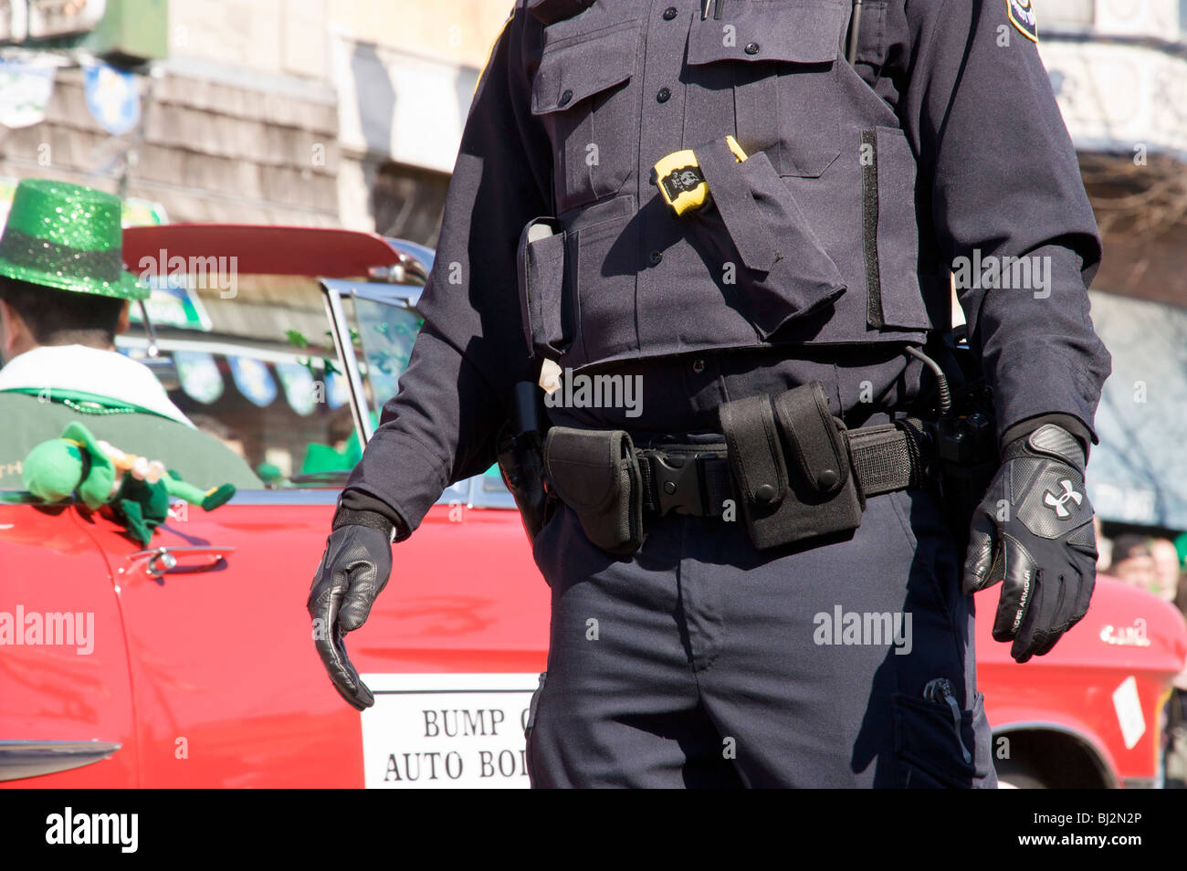 police officer torso with body armor and taser stock photo