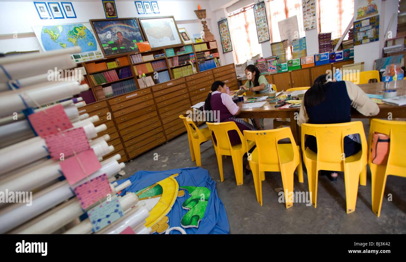 Teacher working in the resource room of Tibetan Children\'s Village ...