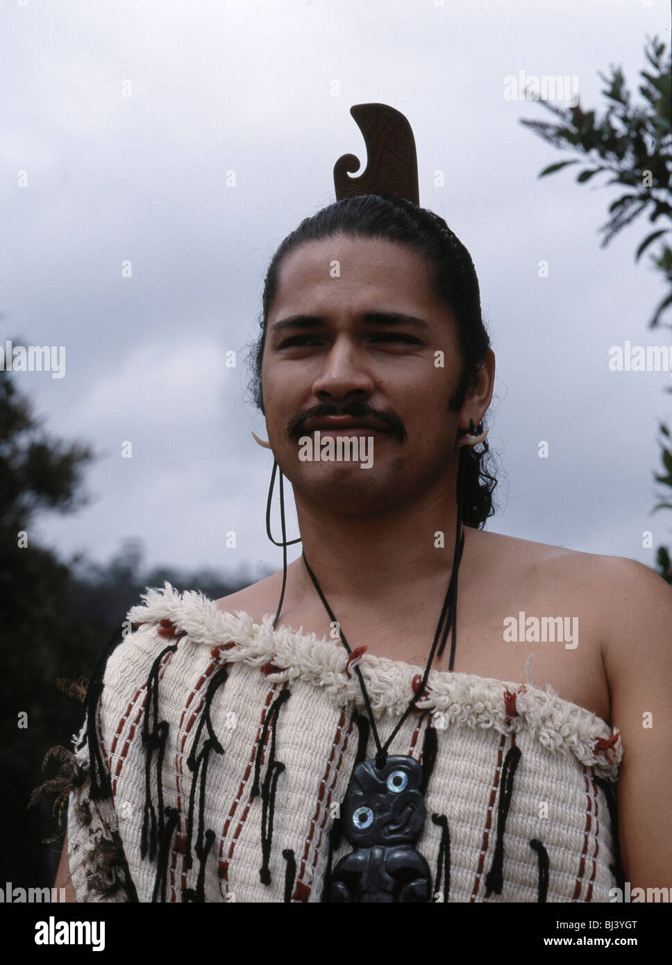 Maori Man: A Maori Man Wearing Traditional Dress And A Hei-tiki