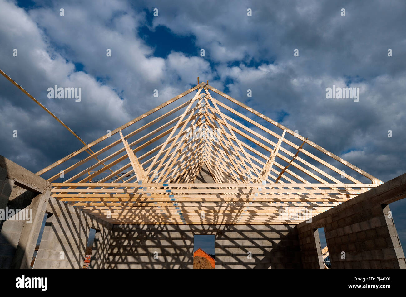 Prefabricated timber roof trusses on building site for Prefabricated roof truss
