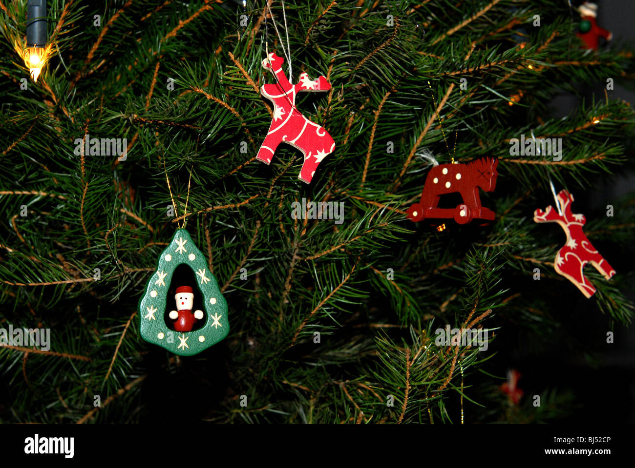 Traditional Wooden Christmas Tree Decorations On A Real