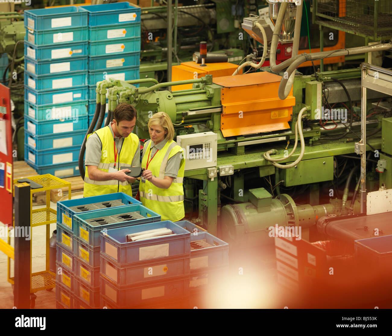 Factory Workers On Floor