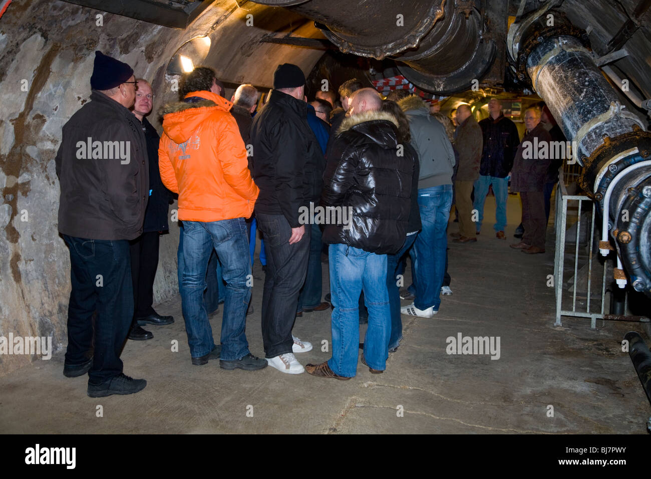 Group of tourists / tourist party tour inside Paris sewers ...