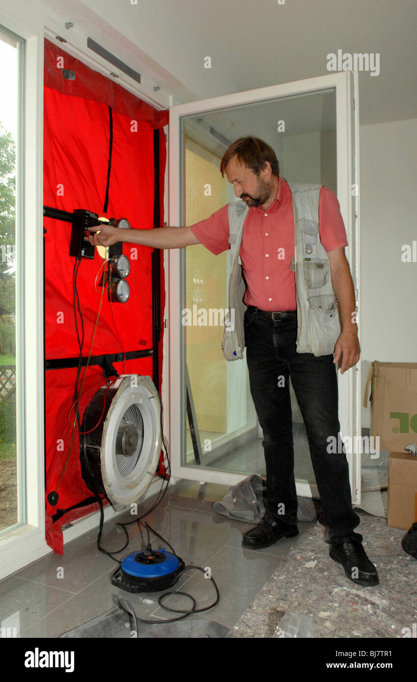 blower door test in a passive house berlin germany stock photo royalty free image 28447301. Black Bedroom Furniture Sets. Home Design Ideas