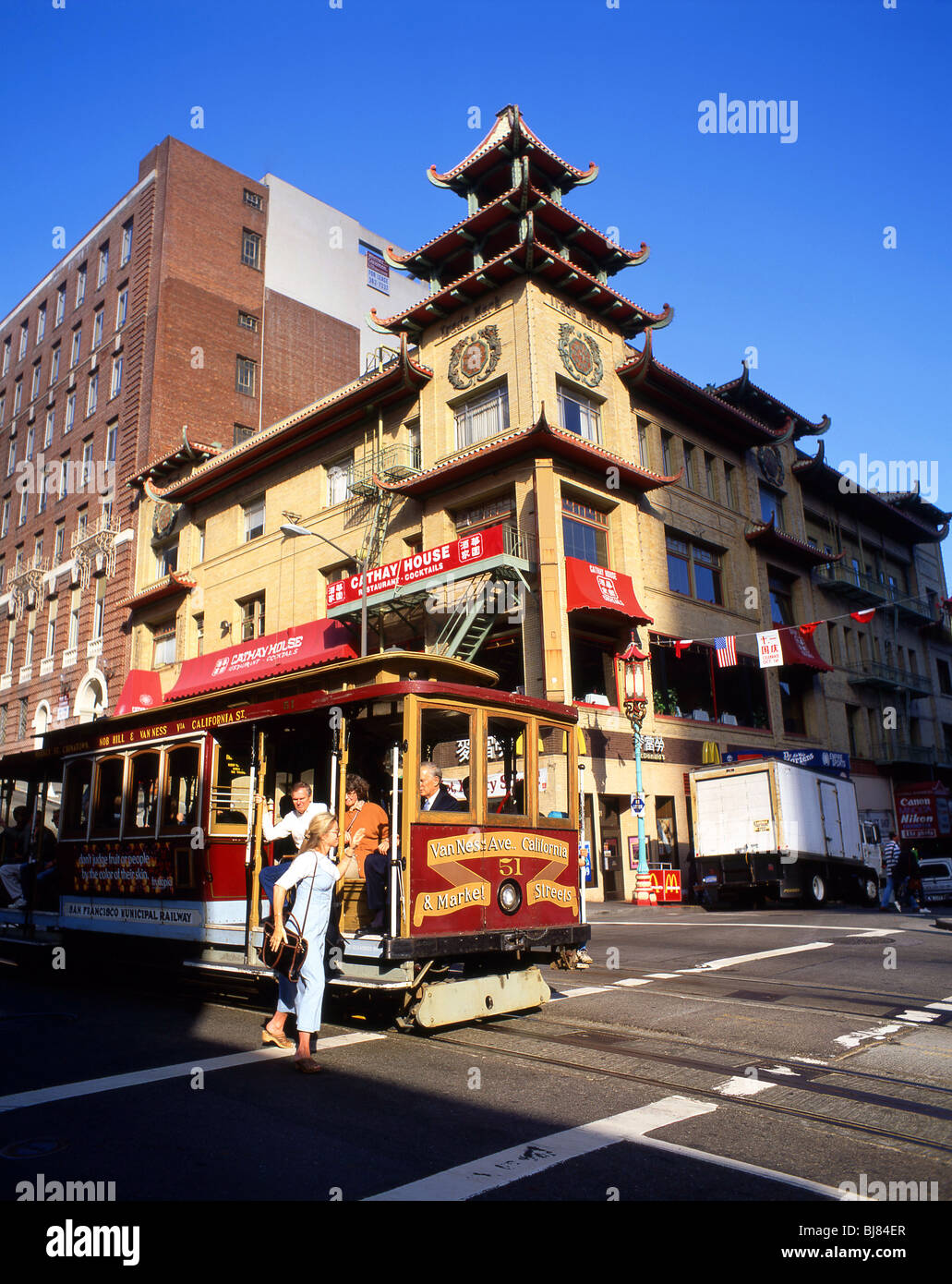 Cable car on street, Chinatown, San Francisco, California, United ...