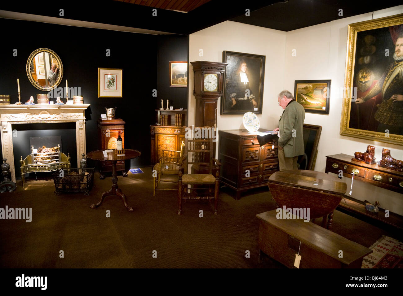 Exhibitor / stall selling antique furniture, and paintings, at the Antiques  & Fine Arts Fair, Kensington Town Hall. London. UK - Exhibitor / Stall Selling Antique Furniture, And Paintings, At The