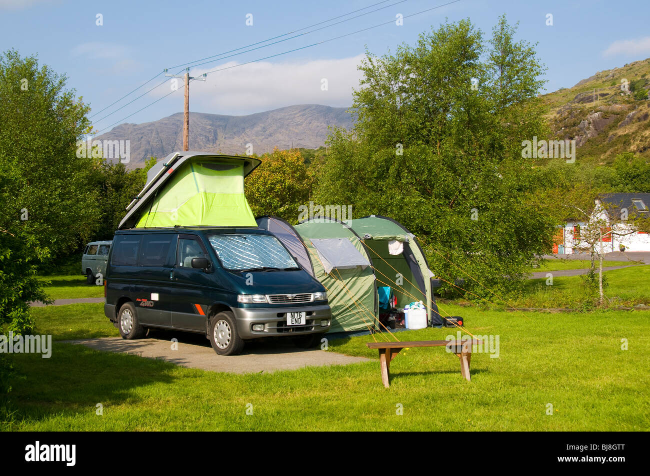 A Small Campervan With Side Awning On Camp Site At Adrigole Beara Peninsula County Cork Ireland Hungry Hill Behind