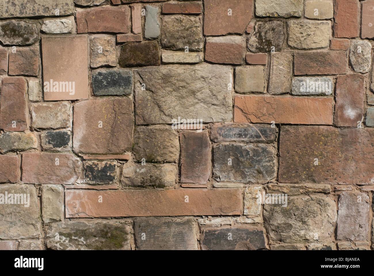 Granite Stone Sandstone : A solid stone wall made of sandstone limestone and granite