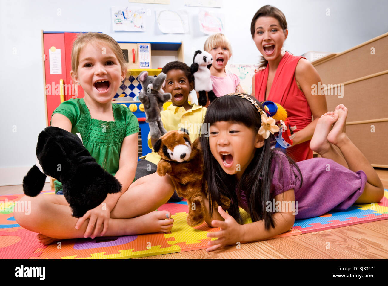 Kinder Garden: Teacher With Preschool Children Playing With Puppets Stock