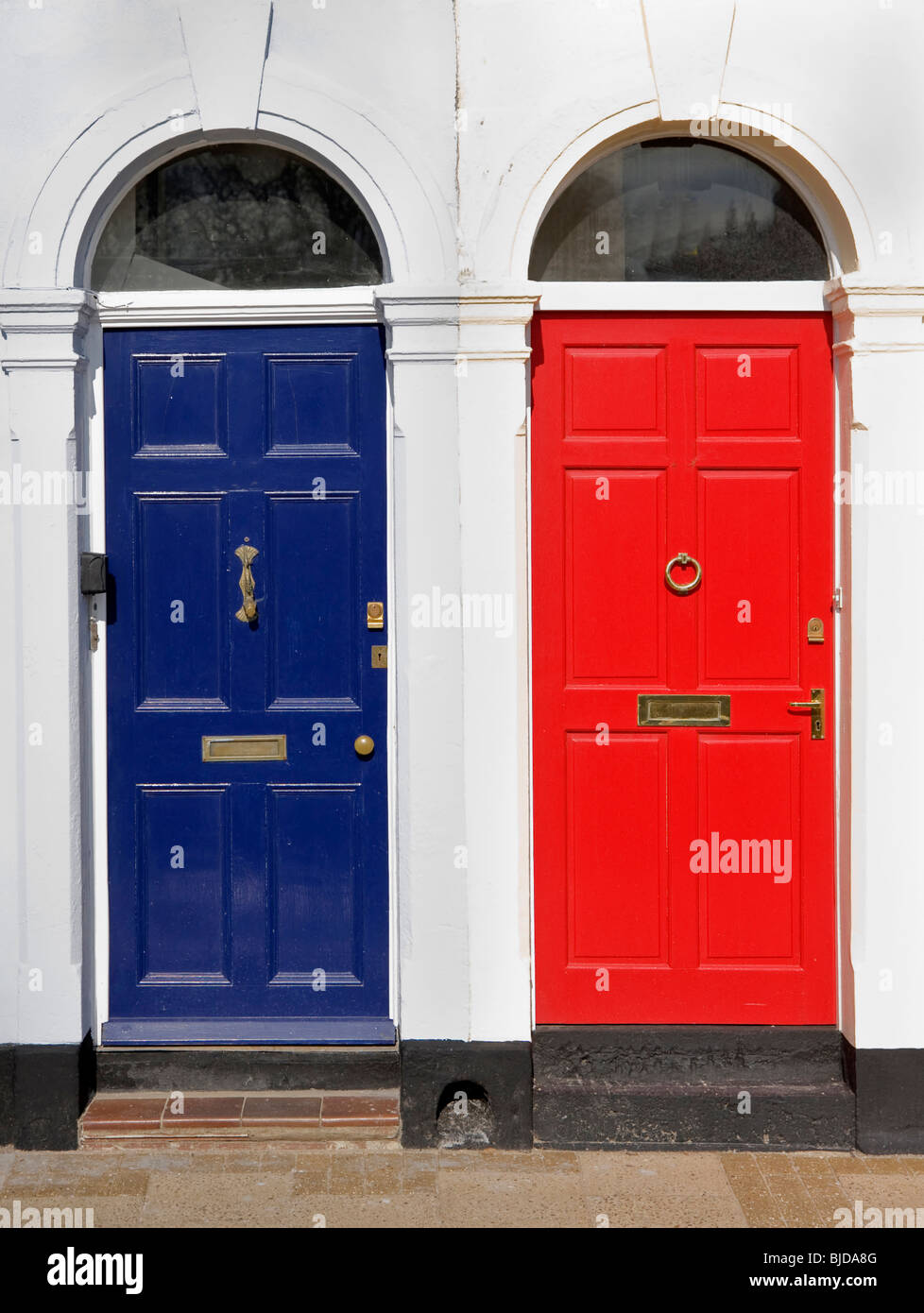 blue front doorsRed and blue front doors with victorian design architraves Stock