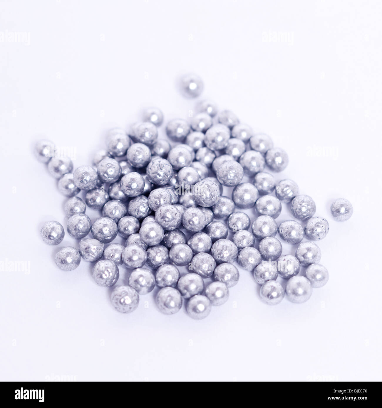 Cake Decoration Silver Balls : A pile of silver balls for cake decorating on a white ...