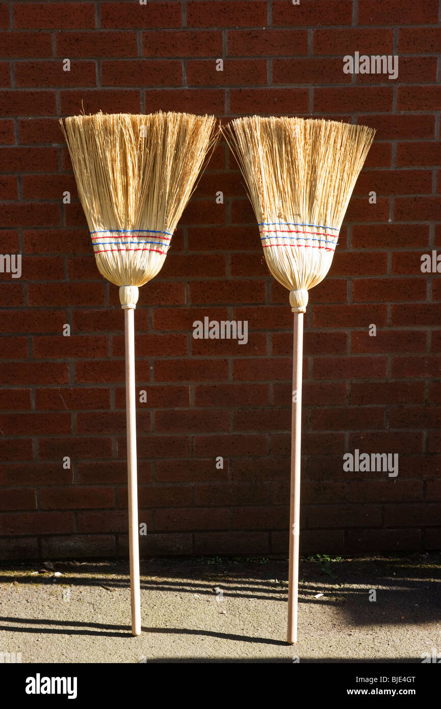 two-brooms-for-sale-and-on-display-outsi