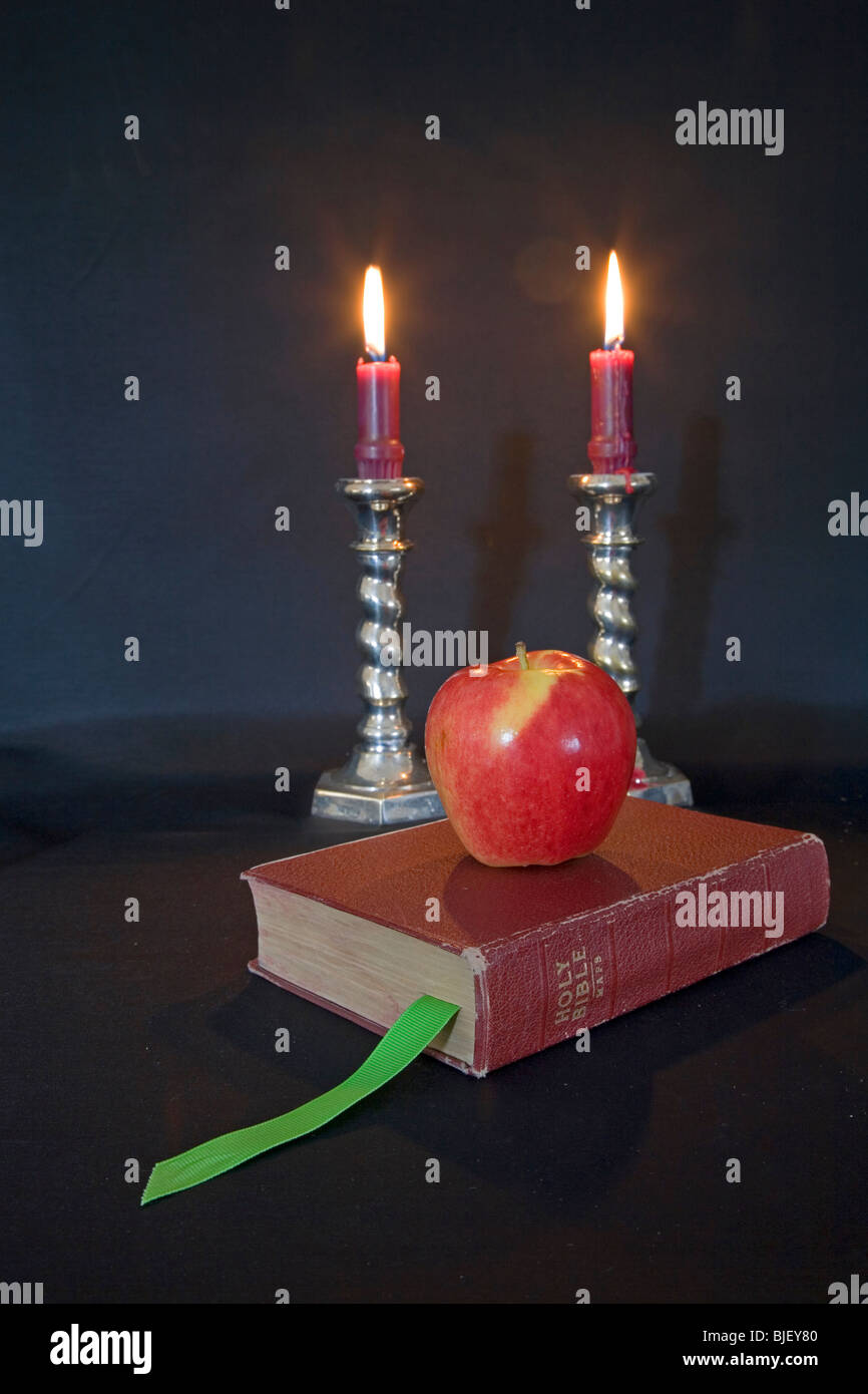 lighted candles reading glasses and a book stock