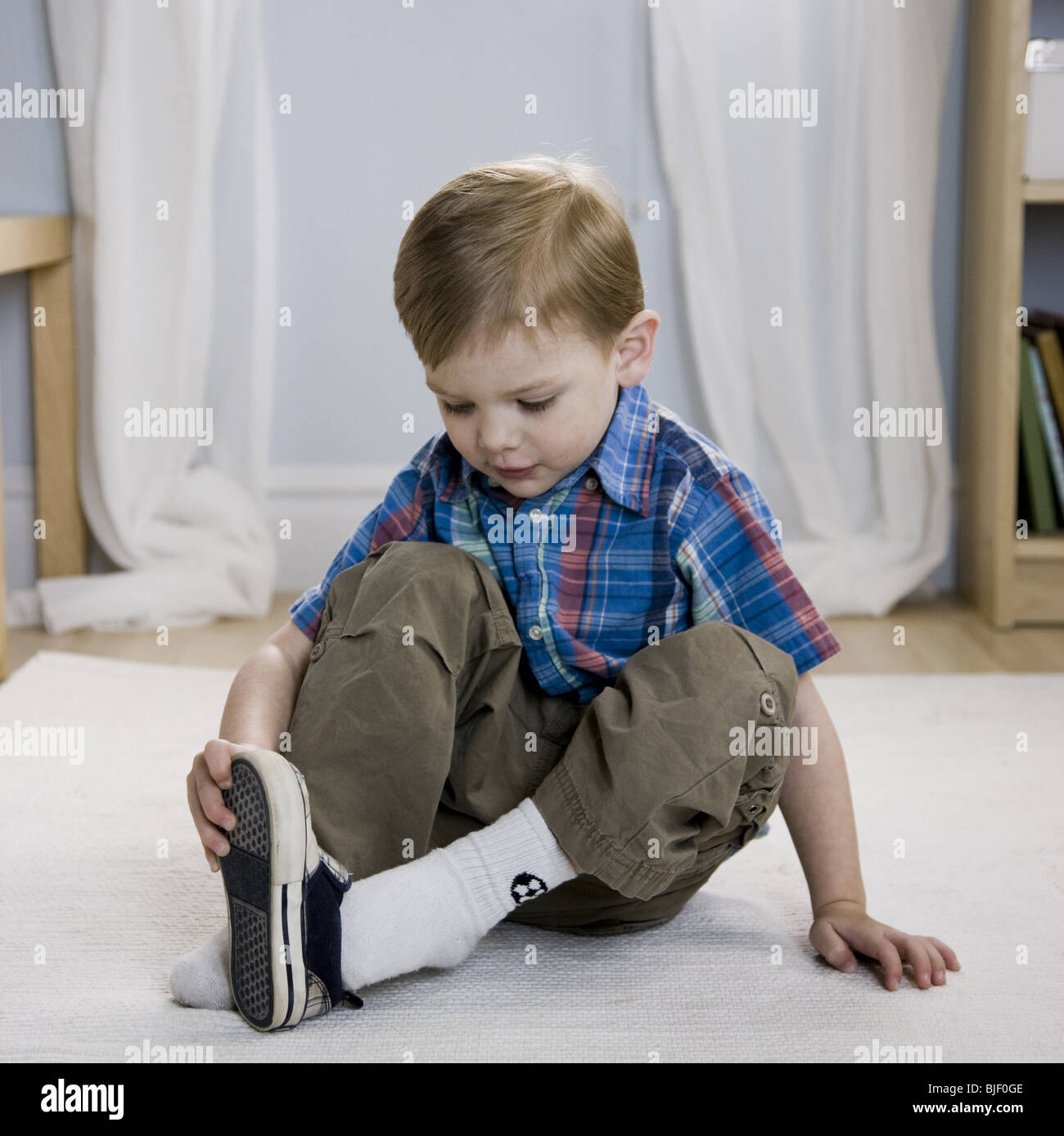 Little Boy Putting On Shoes Stock Photo Royalty Free Image 28603918 Alamy