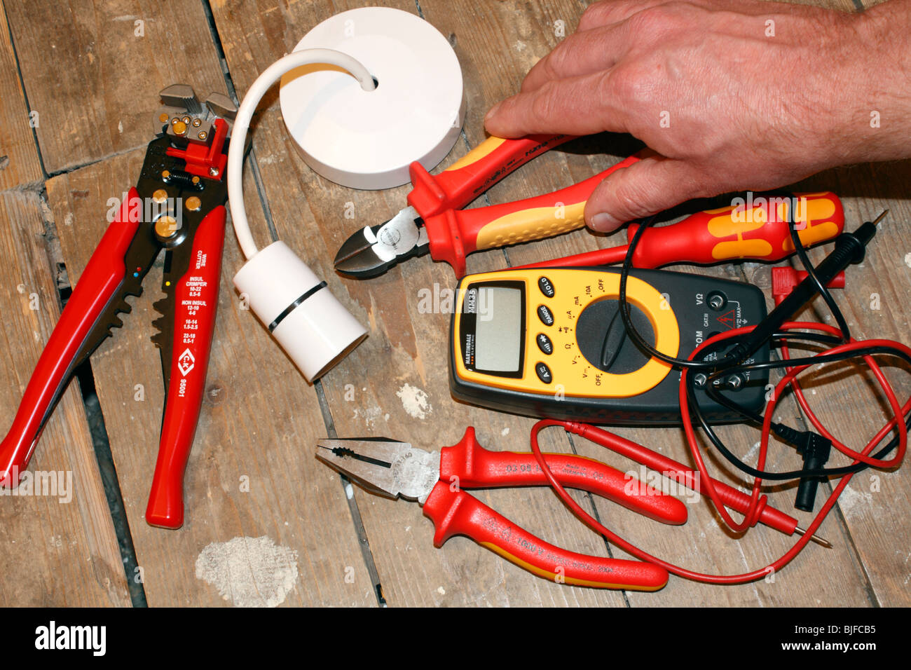 A selection of electrical tools and a ceiling rose Stock Photo ...