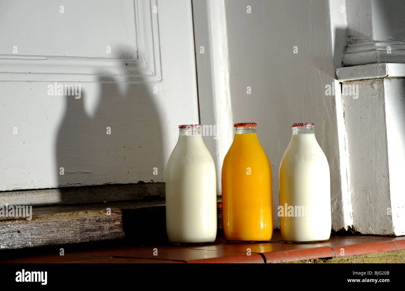 Bottles Of Milk And Orange Juice On A Doorstep Delivered