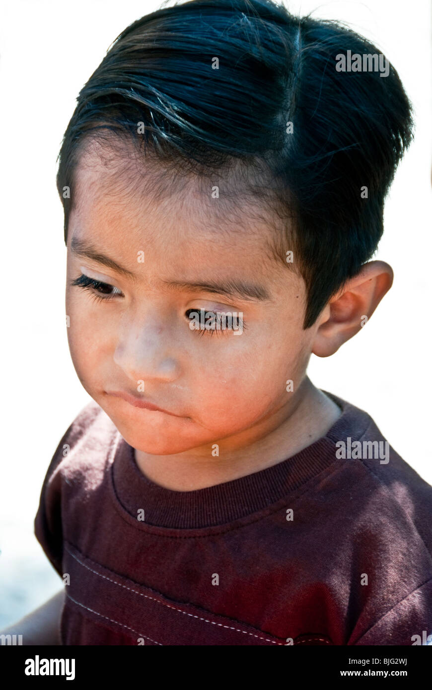 street portrait of small dark eyed Mexican boy with big ...