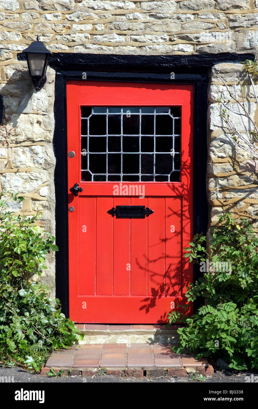 An Old Red Door To The Front Of An English Country Cottage Stock Photo Royalty Free Image