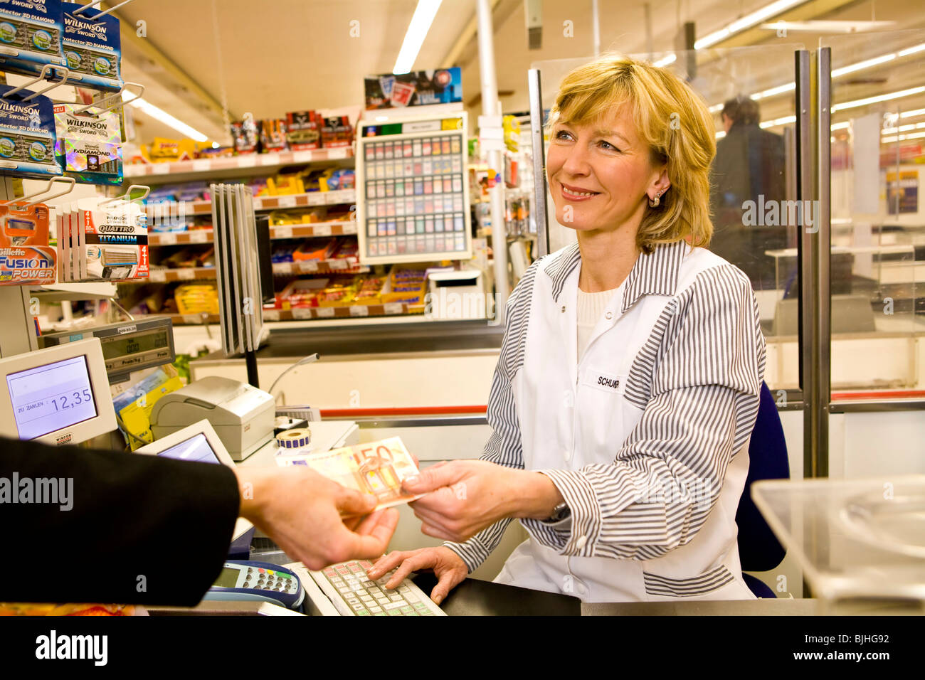 female cashier in the supermarket stock photo royalty free image