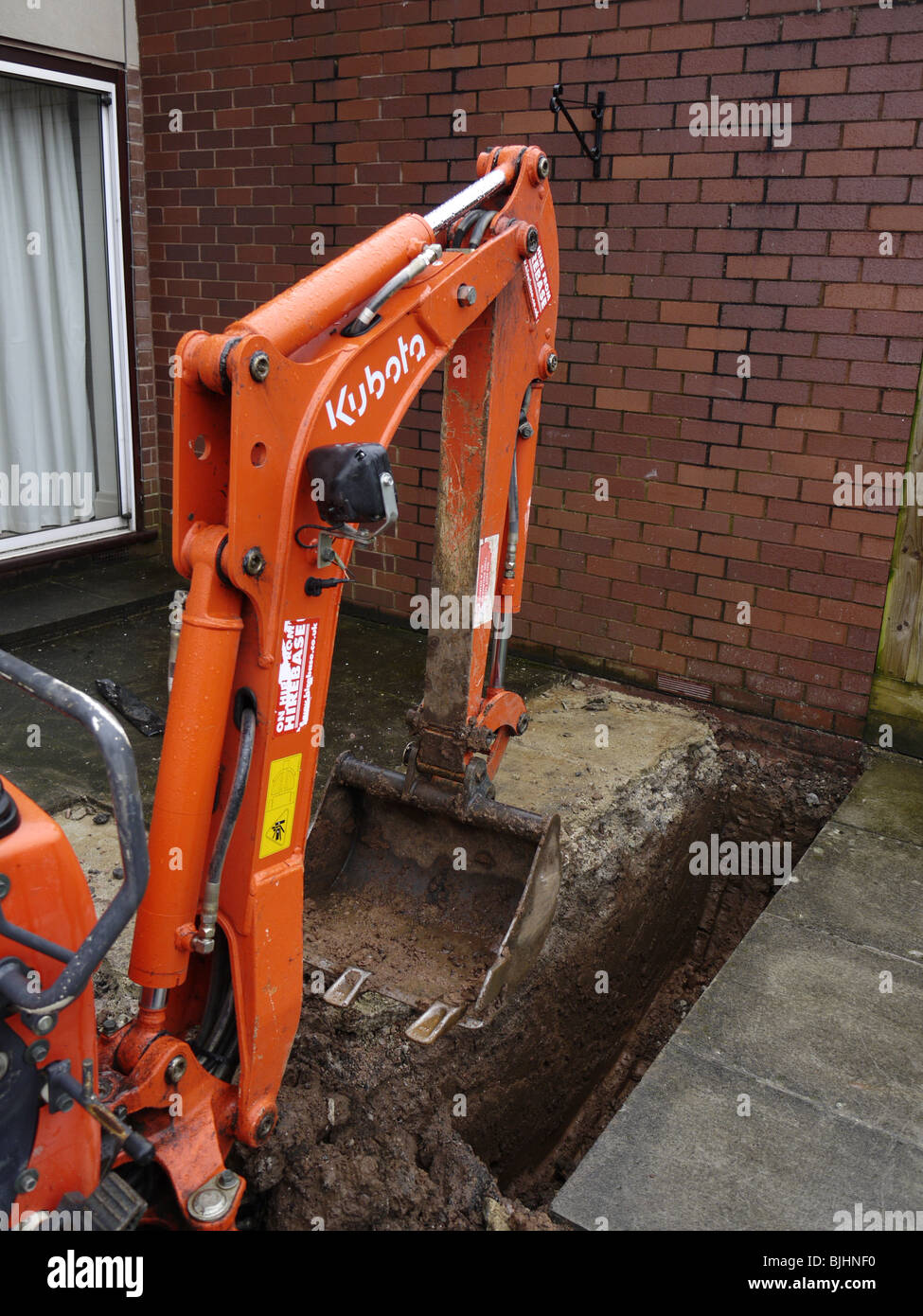 Kubota mini digger digging foundations for extension to for Digging foundation for house