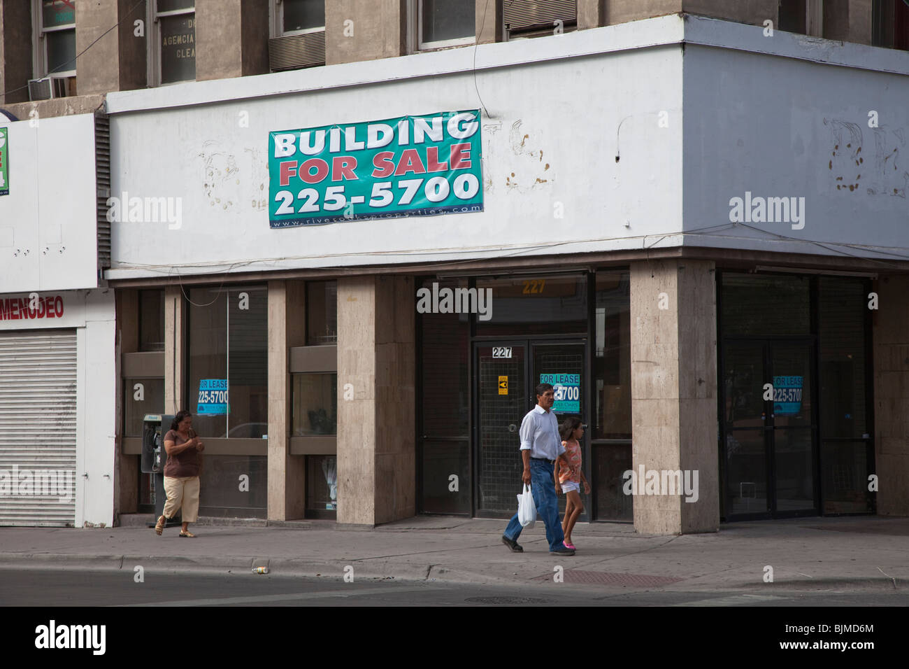 people walking past building for closed shop el paso people walking past building for closed shop el paso texas usa
