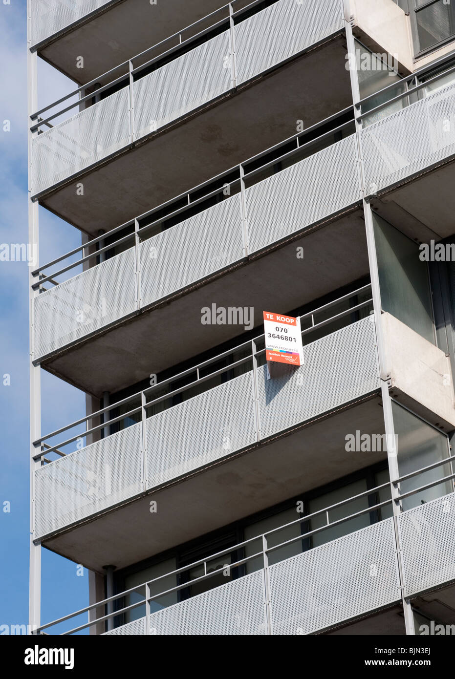 Modern Apartment Building With For Sale Sign On Balcony In The