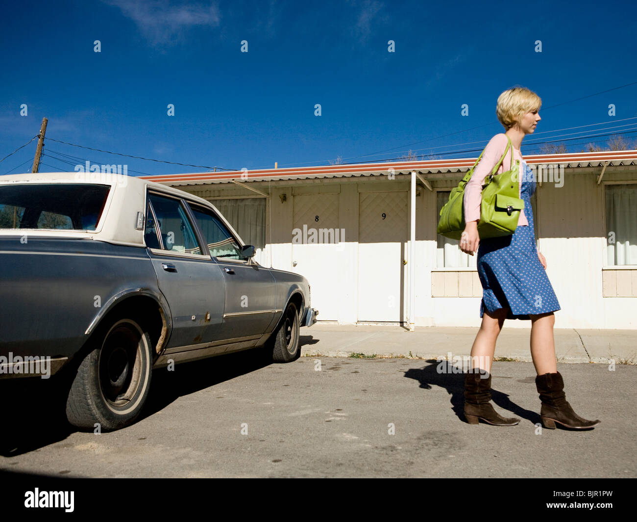 woman getting into an old car Stock Photo, Royalty Free Image ...