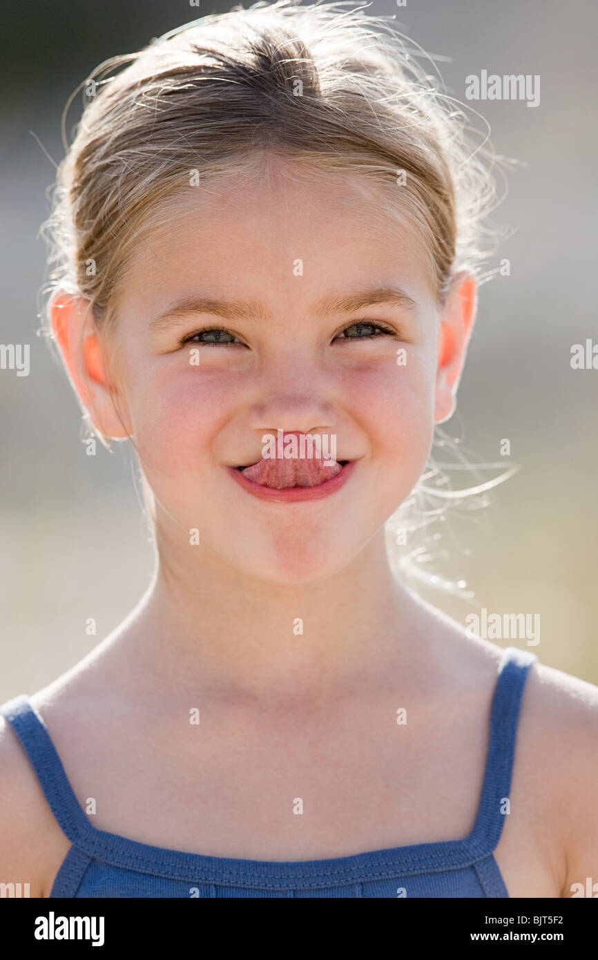 Girl Touching Nose With Tongue Stock Photo Royalty Free