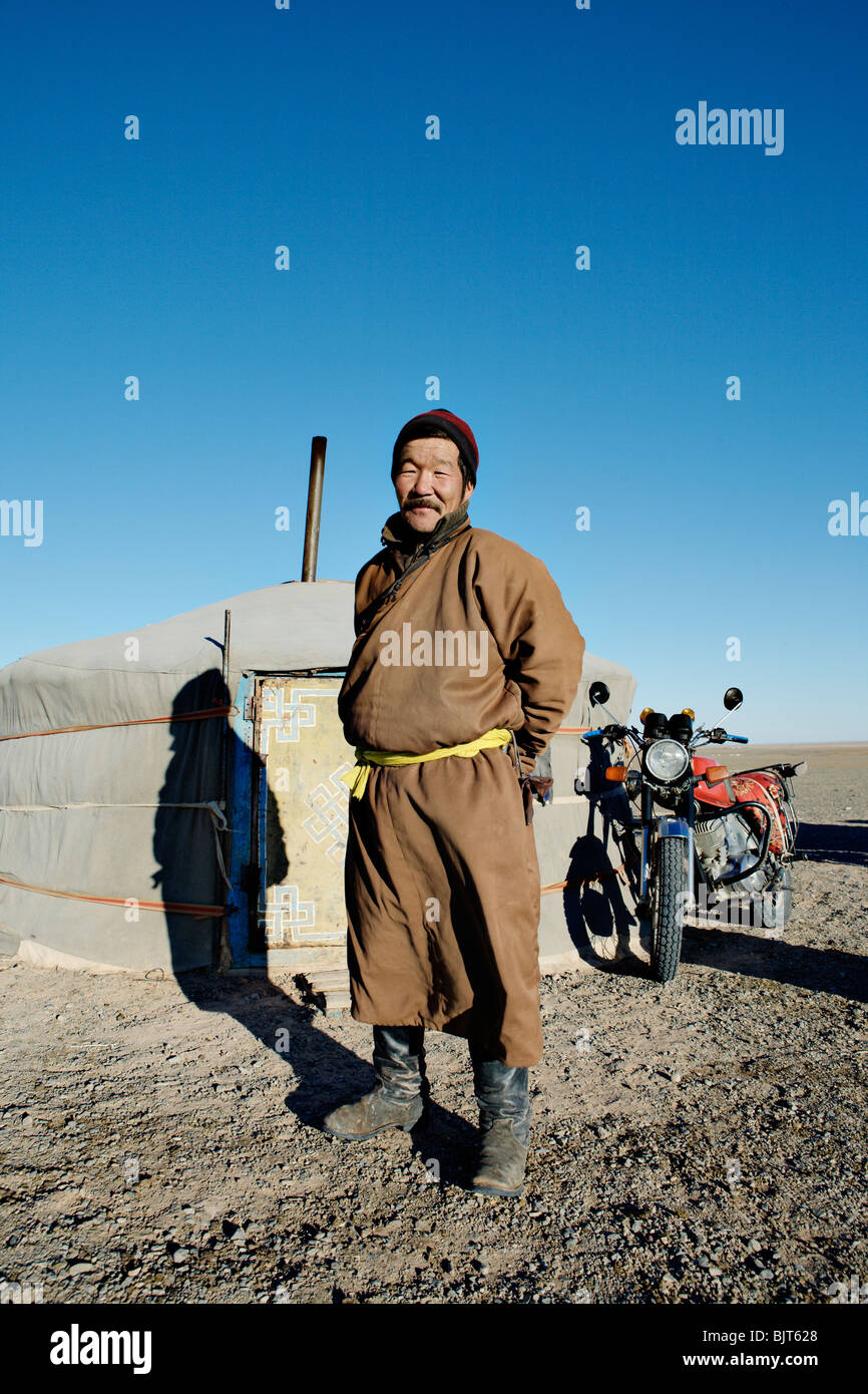 Man with his yurt (felt tent) and motorbike in Gobi Desert Mongolia  sc 1 st  Alamy & Man with his yurt (felt tent) and motorbike in Gobi Desert ...