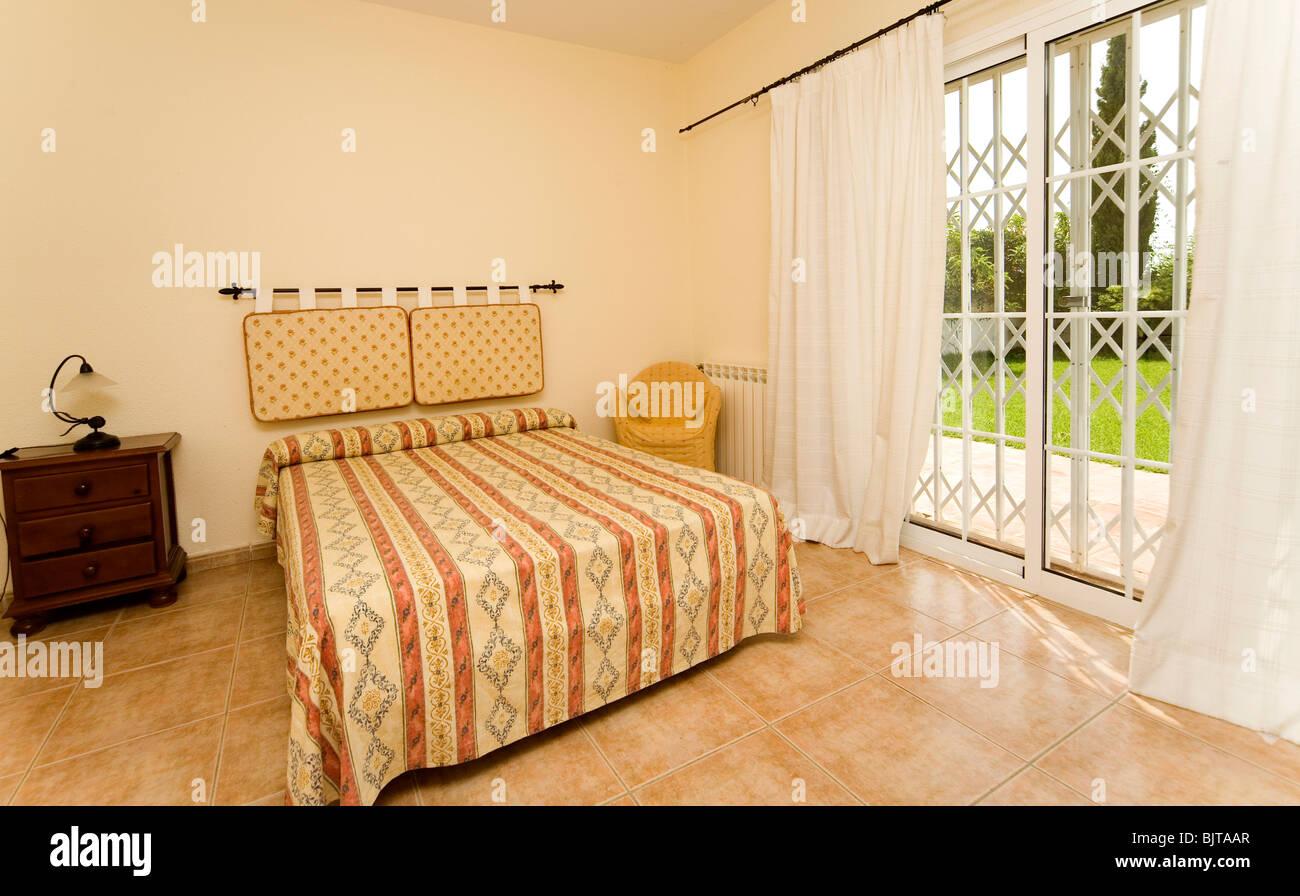 ground floor hotel bedroom with a sliding security door