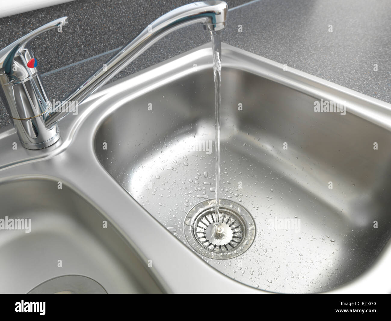 Water Running From Tap Into Kitchen Sink Basket Strainer Stock ...
