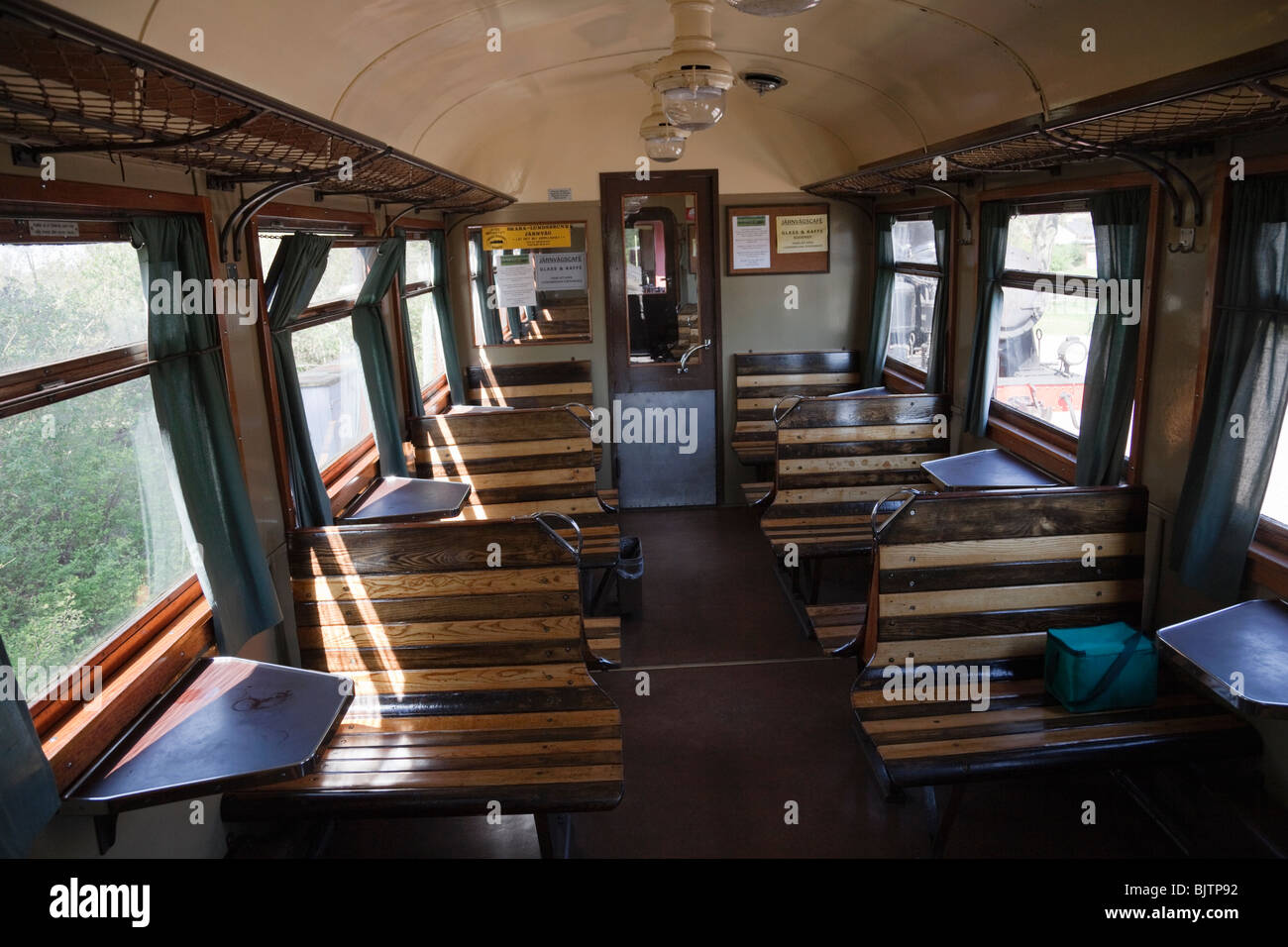 Interior Of An Old Railway Carriage With Wooden Benches
